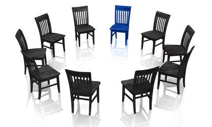 black chairs and one blue chair in circle