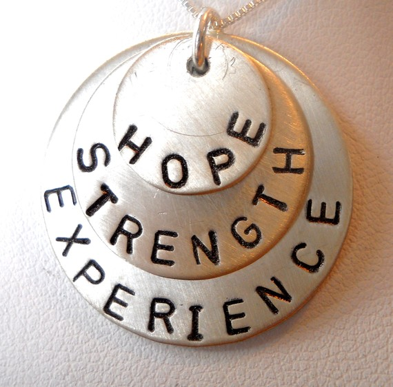 necklace with hope, strength, and experience lettering